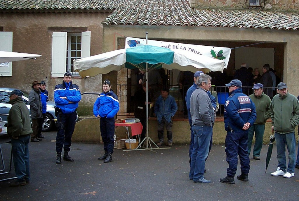 Gendarmes in the Aups Truffle Market. Photo by Pamela J. O'Neill